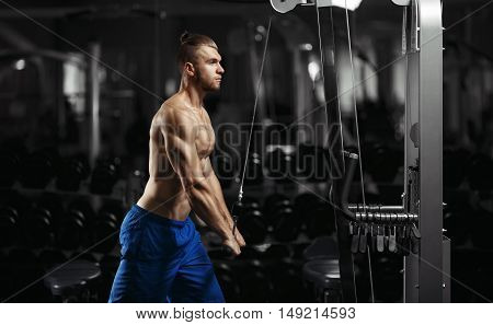 poster of Bodybuilding. Muscular fitness man doing exercises in the gym. Fitness - concept of healthy lifestyle. Fitness man in the gym. Bodybuilder man in the gym.