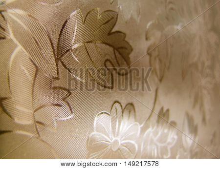 Unusual window foil flower background sepia coloured
