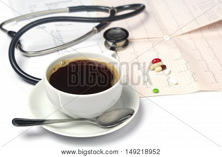 Cup of hot coffee electrocardiogram and phonendoscope
