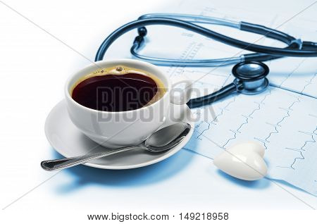 Coffee electrocardiogram and phonendoscope on white background
