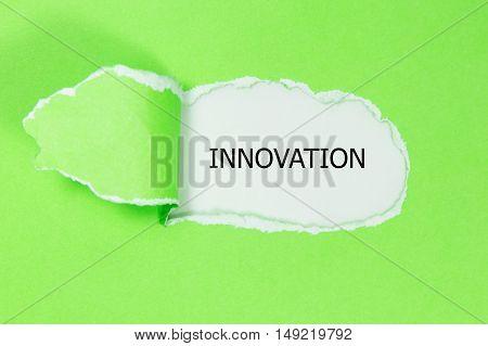 innovation word under torn paper, torn paper