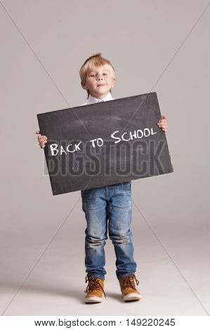 Kid Holding A Black Board With Sign - Back To School