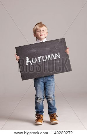 Kid holding board with sign Autumn. Kid holding board with sign Menu. On a white background.