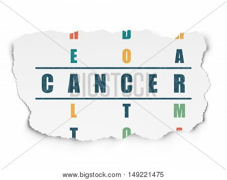 Healthcare concept: Painted blue word Cancer in solving Crossword Puzzle on Torn Paper background