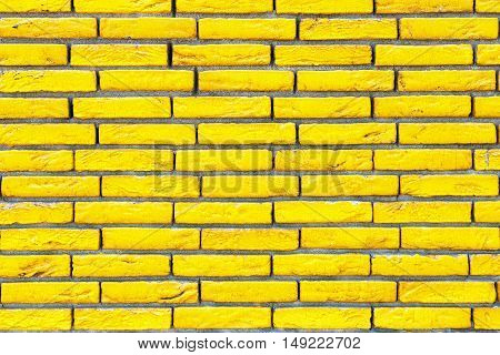 Background of yellow brick wall texture close up