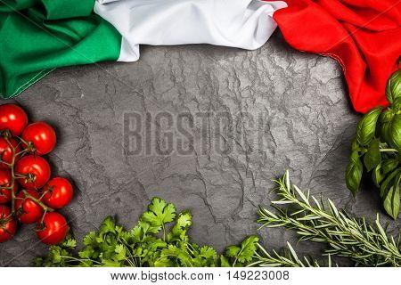 Fresh herbs on grey background