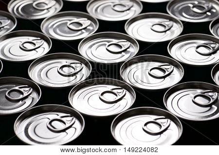 Closeup of a group of aluminium cans.