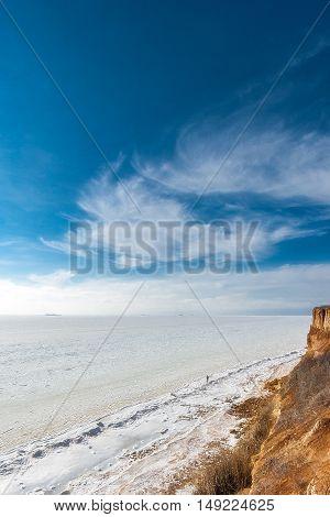 Beautiful winter seascape. Black Sea is covered with ice. The northern coast of the Black Sea region of Odessa Ukraine.