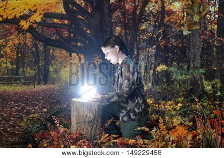 An attractive elementary explorer amazed at the brilliant globe she's found in the autumn woods.