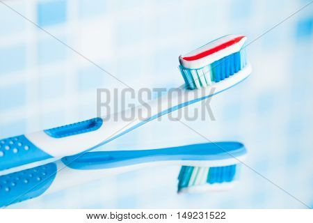 toothbrush with red stripe toothpaste