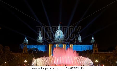 Barcelona, Spain. Magic Fountain of Montjuic laser and water show at night. The fountain is located close to Plaza de Espana. Light show is accompanied by music some nights of the week.