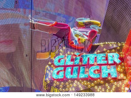 LAS VEGAS - JUNE 18 : Cowgirl neon sign in downtown Las Vegas on June 18 2016. The iconic sign of Glitter Gulch is placed in 20 East Fremont Street in Downtown Las Vegas