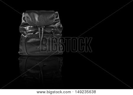 luxury leather black hand bag with dual small bag and zipper on front for man or woman on black background and reflection shadow isolated included clipping path