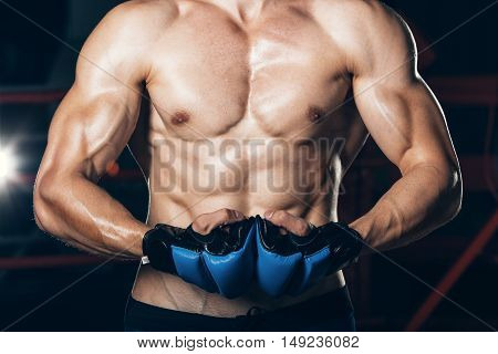 Muscular Fighter kickbox With blue gloves. muscular body