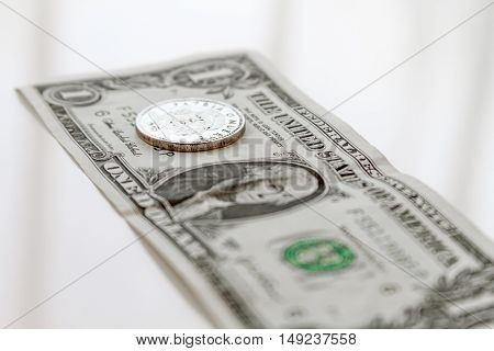 Dollar Bill With A Coin Three Cuban Pesos Over White Background