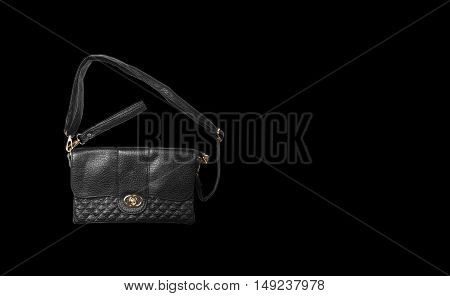 top view chic and luxury leather black hand bag with sling strap and zipper for woman on black background and reflection shadow isolated included clipping path