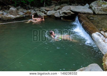 beautiful girl with her daughter swimming in the river wet, woman, youth