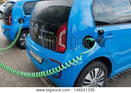 Vilnius, Lithuania - September 22, 2016: Volkswagen Spark electric car connected to charge station at day time