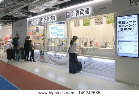 TOKYO JAPAN - SEPTEMBER 23, 2016: Unidentified people exchange money at Narita Airport Tokyo.