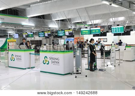 TOKYO JAPAN - SEPTEMBER 23, 2016: Unidentified people check in for Spring Airline flights at Narita Airport Tokyo. Spring Airline is a Chinese low cost carrier headquartered in Shanghai.
