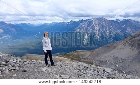 Woman hiker on mountain top. Canadian Rocky Mountains. Alberta. Canada.