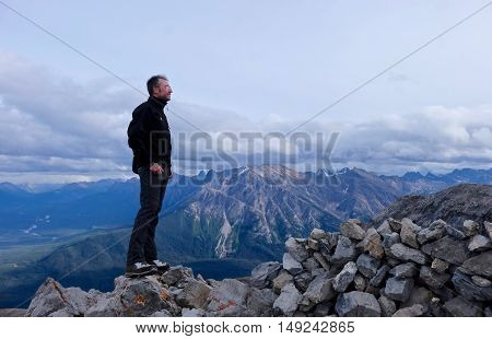 Man hiker on mountain top. Canadian Rocky Mountains. Alberta. Canada.