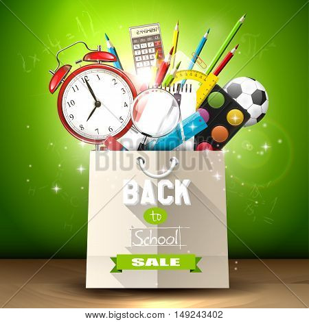 School supplies in a shopping bag - back to school sale concept