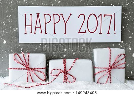 Three Christmas Presents On Snow. Cement Wall As Background With Snowflakes. Modern And Urban Style. Card For Birthday Or Seasons Greetings. Label With English Text Happy 2017 For Happy New Year
