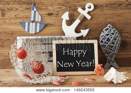 Blackboard With Nautical Summer Decoration And Wooden Background. English Text Happy New Year. Fish, Anchor, Shells And Fishnet For Maritime Contex.