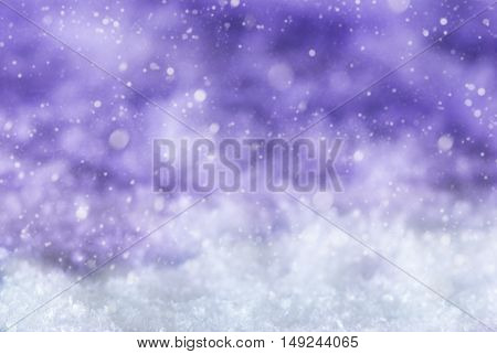 Purple Christmas Texture With Snow And Snowflakes. Copy Space For Advertisement. Card For Seasons Greetings