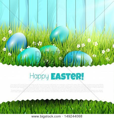 Easter background with blue eggs in grass and copy-space