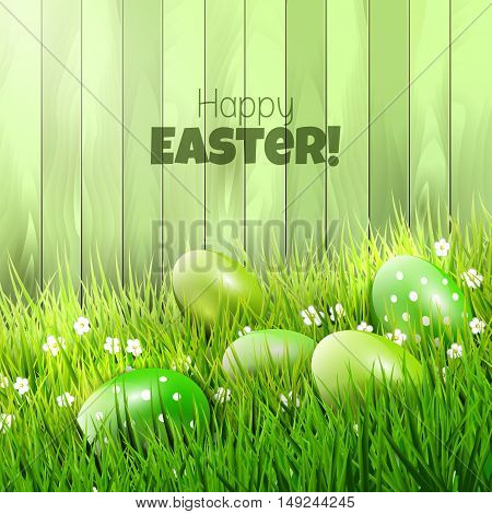 Easter background with green eggs in grass and copy-space