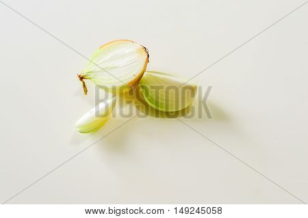 Onion slice on the white isolated background raw food