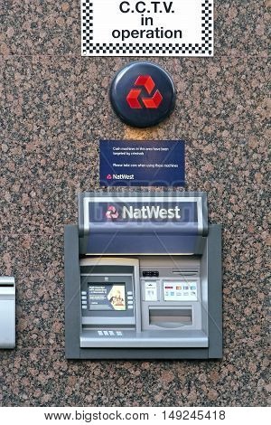 LONDON UK - February 09: NatWest ATM on urban street in London UK - February 09 2015; National Westminster Bank commonly known as NatWest is a large retail and commercial bank in the United Kingdom.