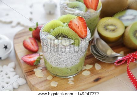 Homemade chia seed pudding with kiwi and strawberry Christmas breakfast