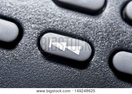 Macro Of A Black Skip Backward Button On Black Remote Control For A Hifi Stereo Audio System