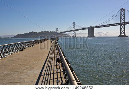 San Francisco promenade Bay bridge fog and Pacific ocean.