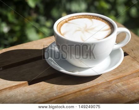 Coffee cup with on wooden table soft focus