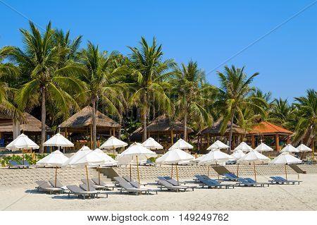 Doc Let beach, Vietnam. Umbrellas and sunbeds