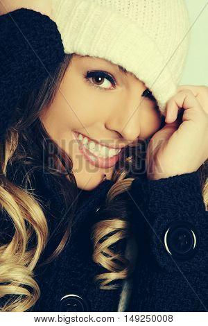 Playful beautiful winter woman wearing hat