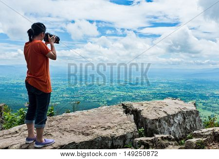 Asian Woman Photographed The Beautiful View, Outdoor On Summer Day. Vintage Tone.