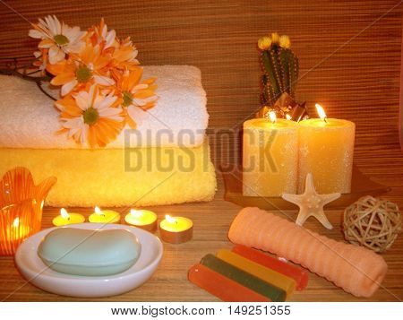 composition of aromatic candles burning yellow, ideal for decorating a spa