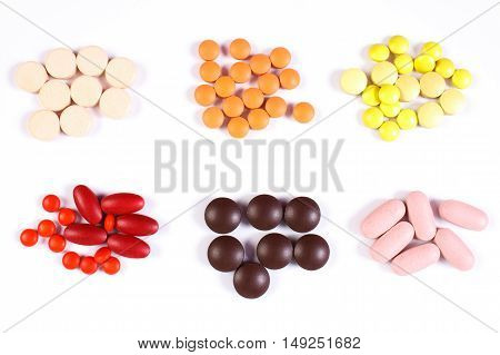 Colorful Medical Pills And Capsules On White Background, Health Care Concept