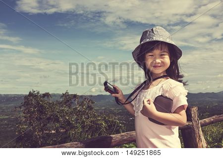 Happy Asian Girl Relaxing Outdoors In The Daytime, Travel On Vacation.