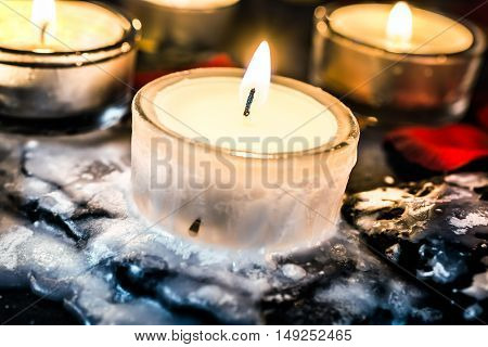 Tealights On Slate With Wax Around The Tea Light That Looks Like Ice