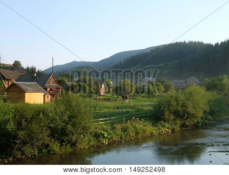 Old Romanian Village View In The Carpathian Mountains, summer day