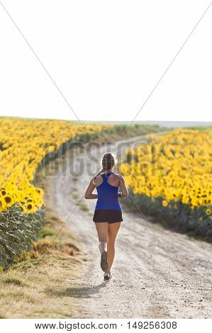 Beautiful Young Woman Running In Countryside.