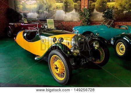 El Segundo, CA, USA - September 26, 2016: Bright yellow 1935 Morgan displayed at the Automobile Driving Museum in El Segundo, California, United States. Editorial use only.