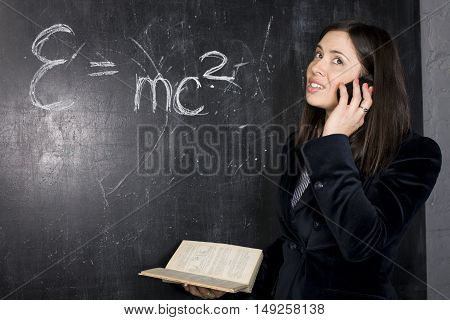 portrait of happy cute student in classroom at blackboard back to school having fun, girl at college