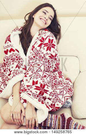 young pretty brunette girl in Christmas ornament blanket getting warm on cold winter, freshness beauty concept, lifestyle people concept